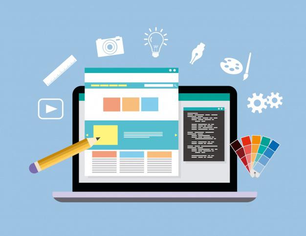 Concepto de diseño web con un lápiz y una pantalla de un ordenador portátil.